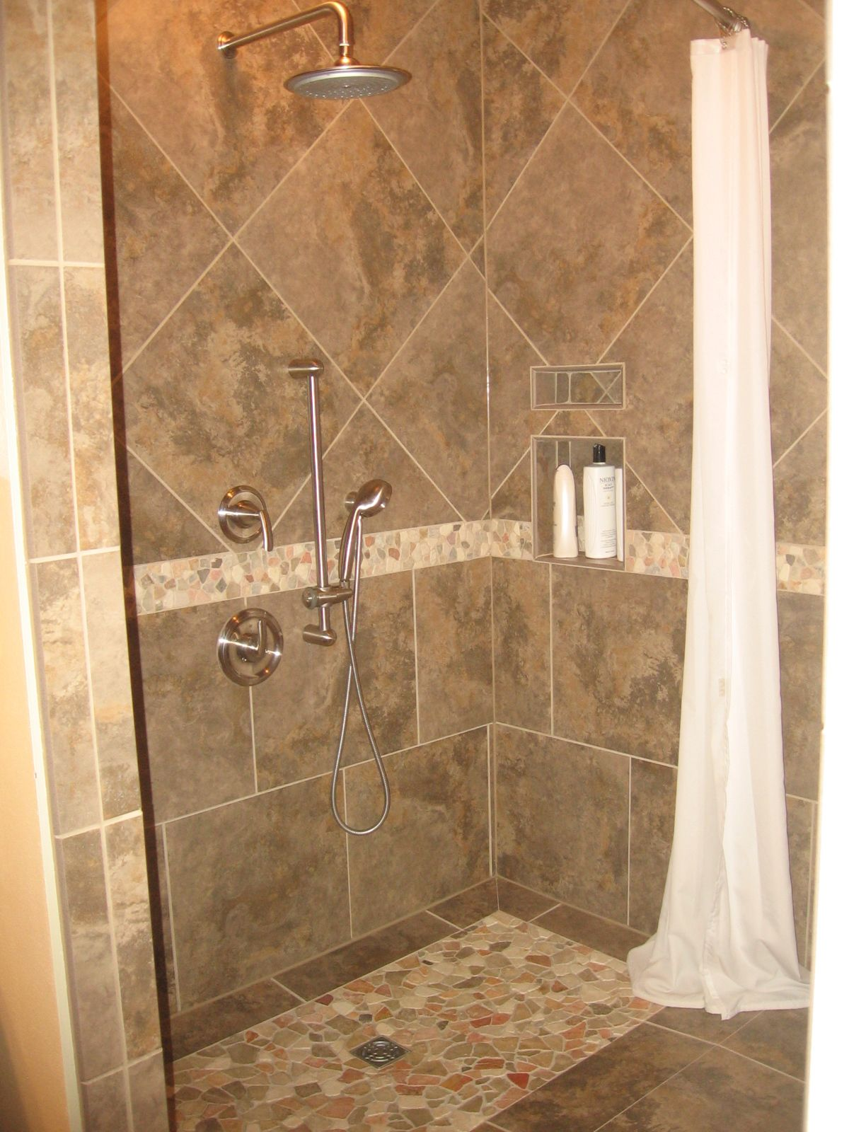Handicapped Accessible shower with a gorgeous faux tile rug.