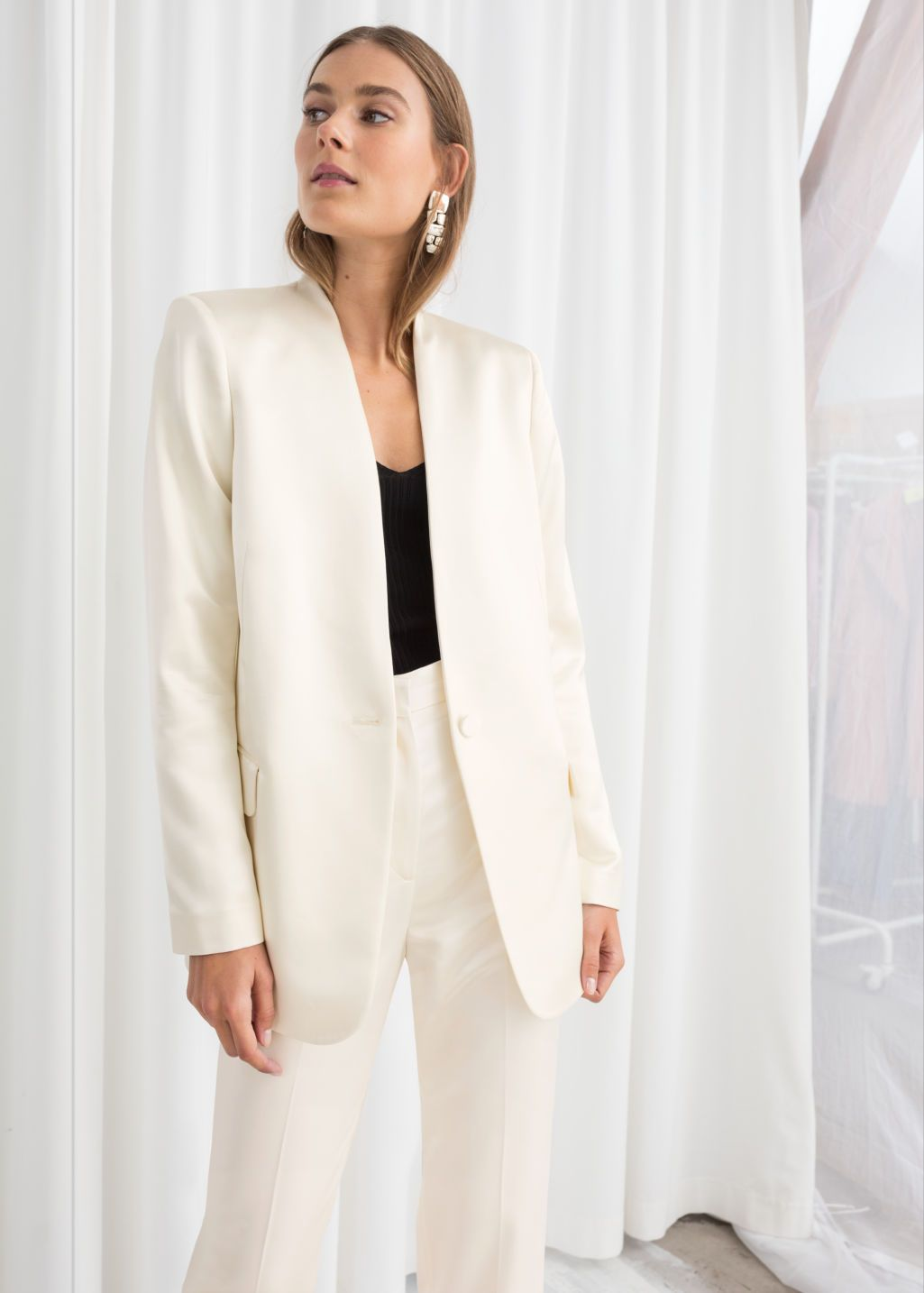 116e3c12d3d Model front image of Stories in white Cream Blazer Outfit