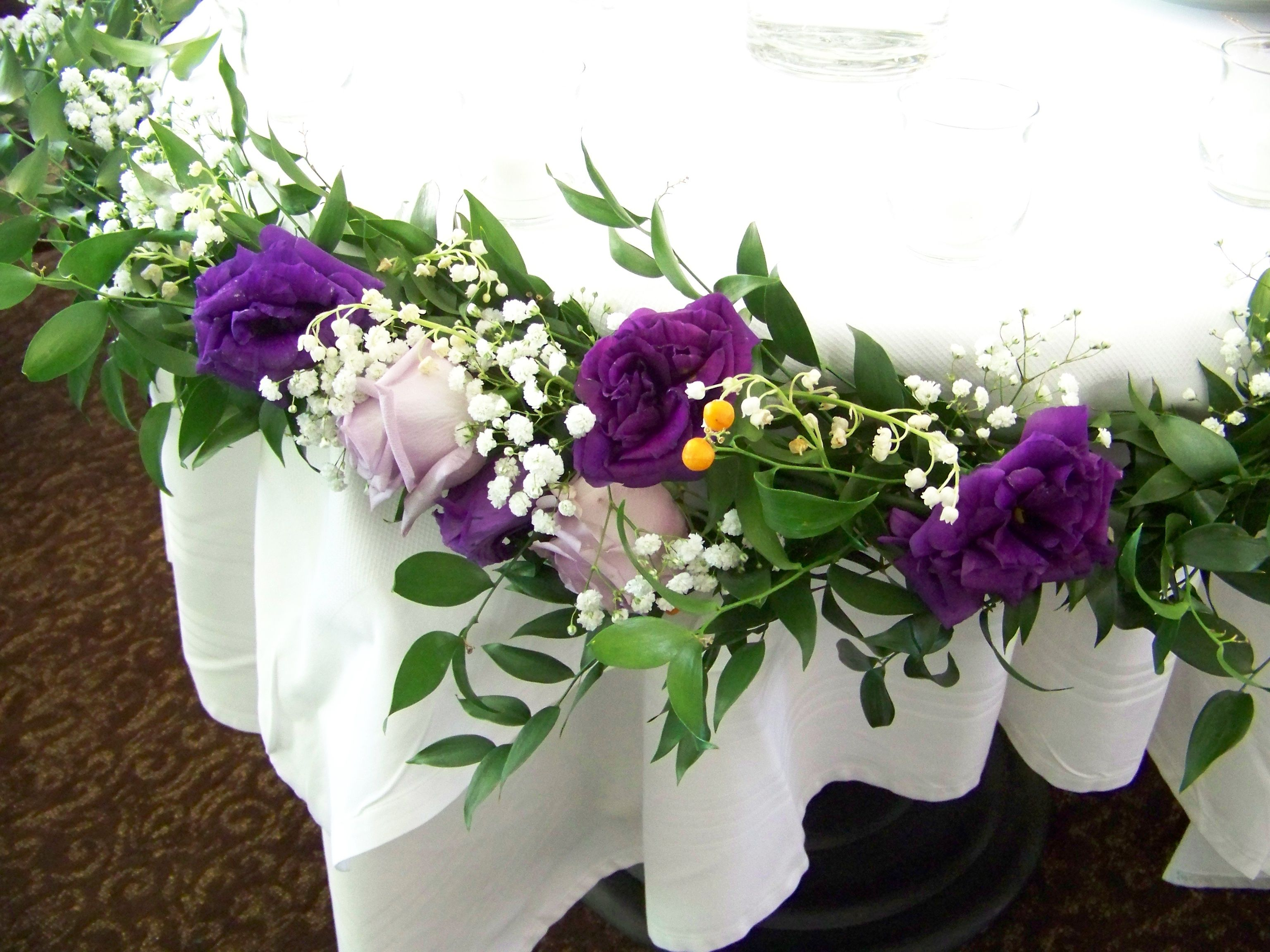 Beautiful Garland With Greens Purple And White Flowers For Sweet Heart Table Decoration White Flowers Purple And White Flowers Flowers