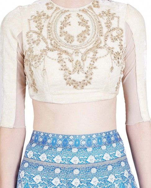 Vanilla cream elbow sleeves crop top with golden baroque embroidery adorning the bodice. Round neckline with zipper back. Wash Care: Dry clean onlySkirt worn by the model is only for styling purpose