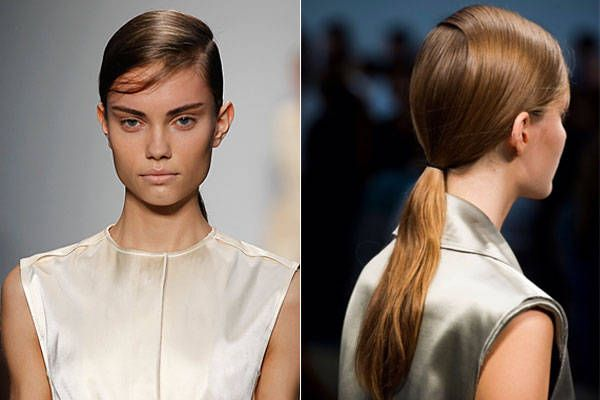 """Orlando Pita, working with Redken, wanted hair that was both precise and modern, but also easy. So he parted models' damp hair deep and on the side, accentuating the part with Redken Guts 10 Root Targeted Volume Spray Foam. He gathered strands into a low ponytail and allowed them to air dry. """"I want [women] to take away the wearability of the hair that is so prevalent in New York fashion,"""" he said.   - HarpersBAZAAR.com"""