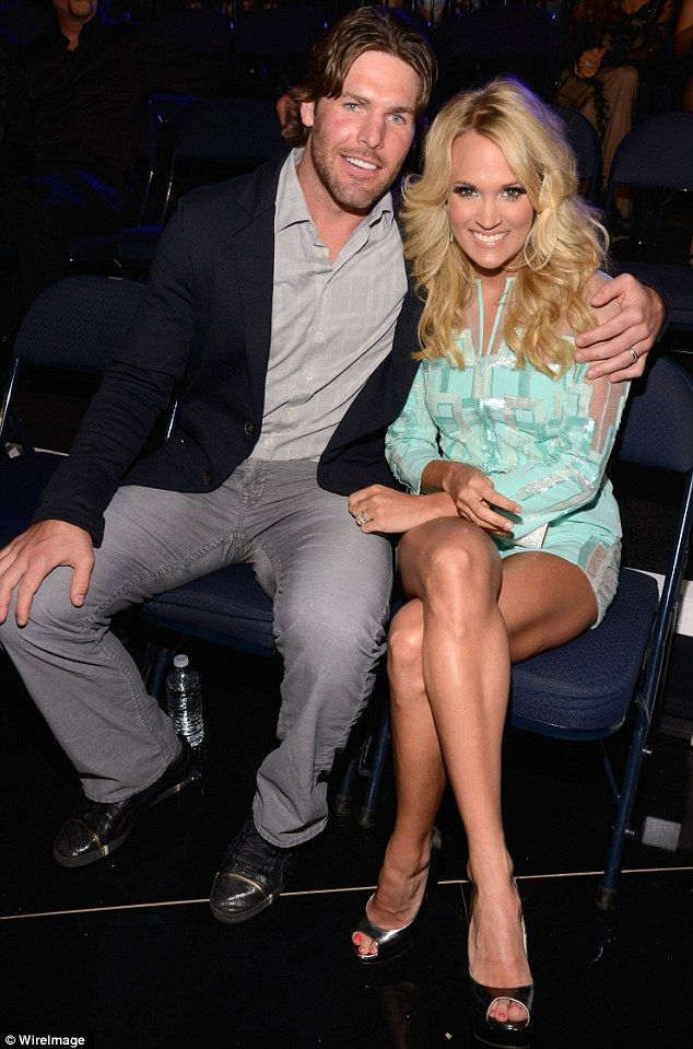 Carrie Underwood wins big at the CMT Awards as Mike Fisher makes a rare red carpet appearance to play the supportive husband