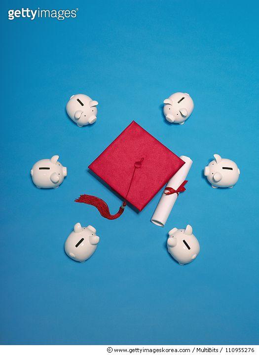 Piggy banks with graduation cap