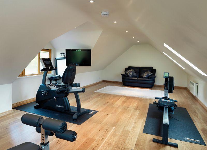 Gym in room above timber garages car port garage gym room at