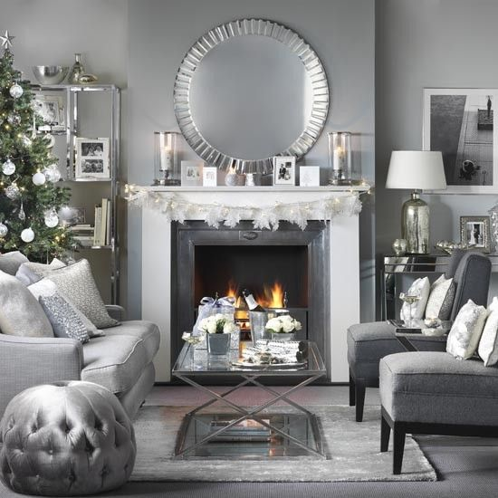 Glass and chrome Christmas living room with open fire ...