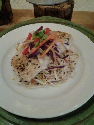 Sesame seared mahi mahi with a rice noodle salad and a asian vegetable slaw