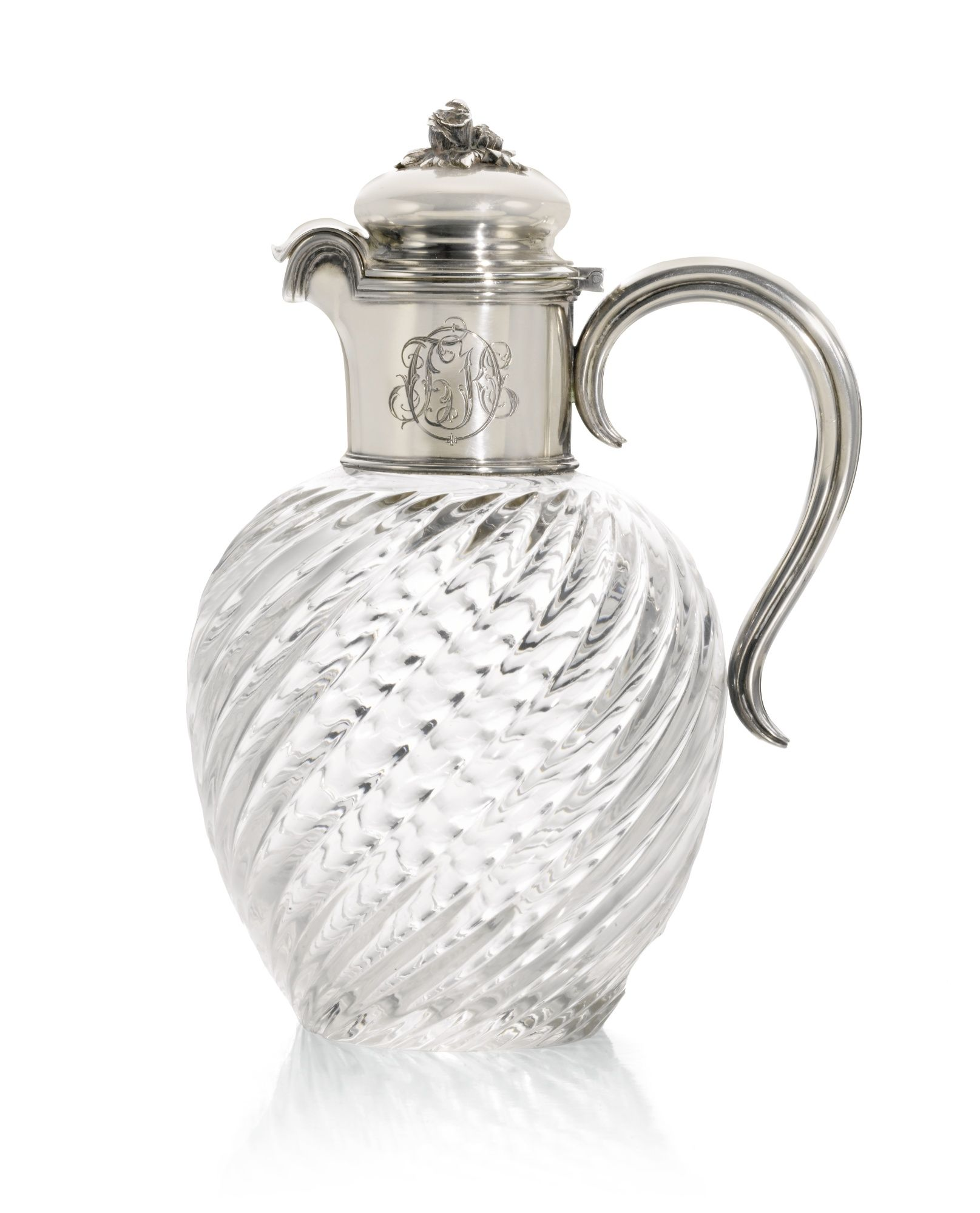 A FABERGÉ SILVER-MOUNTED GLASS DECANTER, MOSCOW, CIRCA 1890 of baluster form, the glass moulded with swirling reeds, the plain neck later dated 1926 and engraved with Cyrillic initials BKO, scroll handle, foliate finial, struck K.Fabergé in Cyrillic beneath the Imperial Warrant, 84 standard, scratched inventory number 3648.