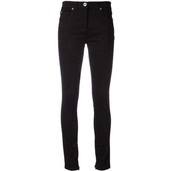 Versace tapered skinny jeans ($578) ❤ liked on Polyvore featuring jeans, black, print jeans, zipper skinny jeans, skinny jeans, button-fly jeans and versace