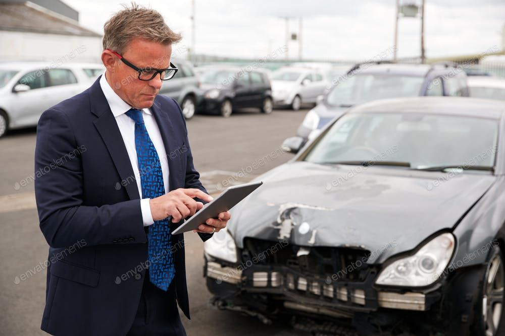 Male Insurance Loss Adjuster With Digital Tablet Inspecting Damage To Car From Motor Accident By Monkeybusinessa S Photos Ad Digital Tablet Accident Photo