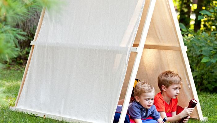 Go camping inside this easy to build drop-cloth tent!