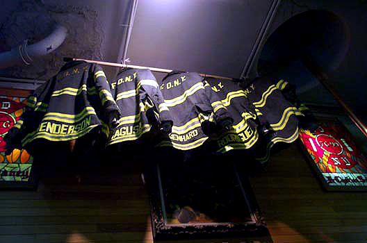 FDNY JACKETS OF THE 5 FALLEN  FIREFIGHTERS  OF ENGINE 279 IN THE RED HOOK FIREHOUSE  IN TRIBUTE OF THESE HEROES
