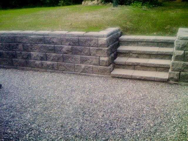 We both like the look of this.  It looks solid and permanent.  Not necessarily these pavers, but the overall look.
