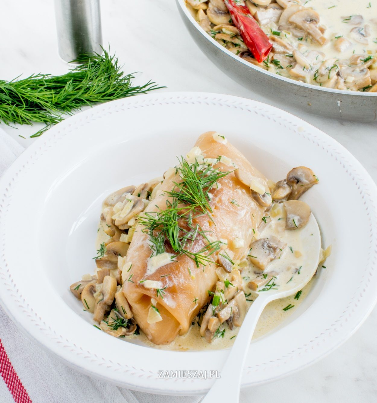 Meat-stuffed cabbage with mushroom sauce
