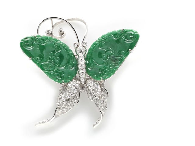 """A carved jadeite jade and diamond butterfly brooch carved jadeite jade """"wings"""" measuring approximately: 28.9 x 23.4mm; estimated total diamo..."""