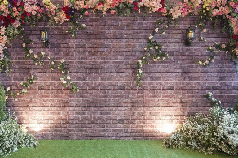 17 Inspiring And Unique Backdrops For Your Ceremony That Are Not Just Flower Arbors Brick Backdrops Brick Wall Backdrop Photo Backdrop Wedding