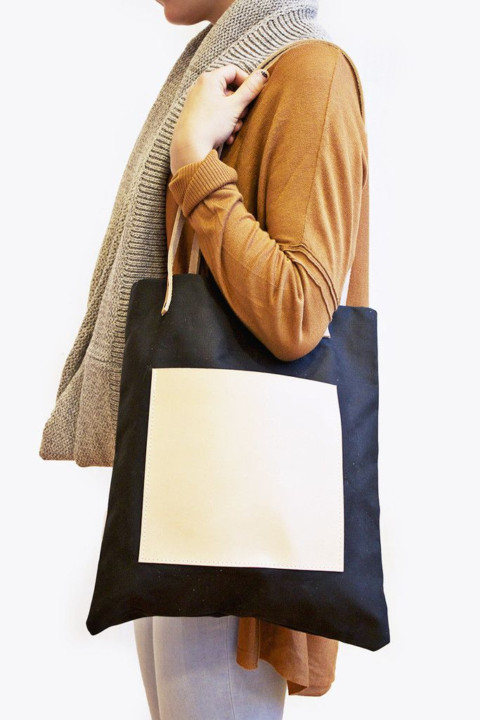 I love this tote. Not only does it go with everything but it has so much space in it too.
