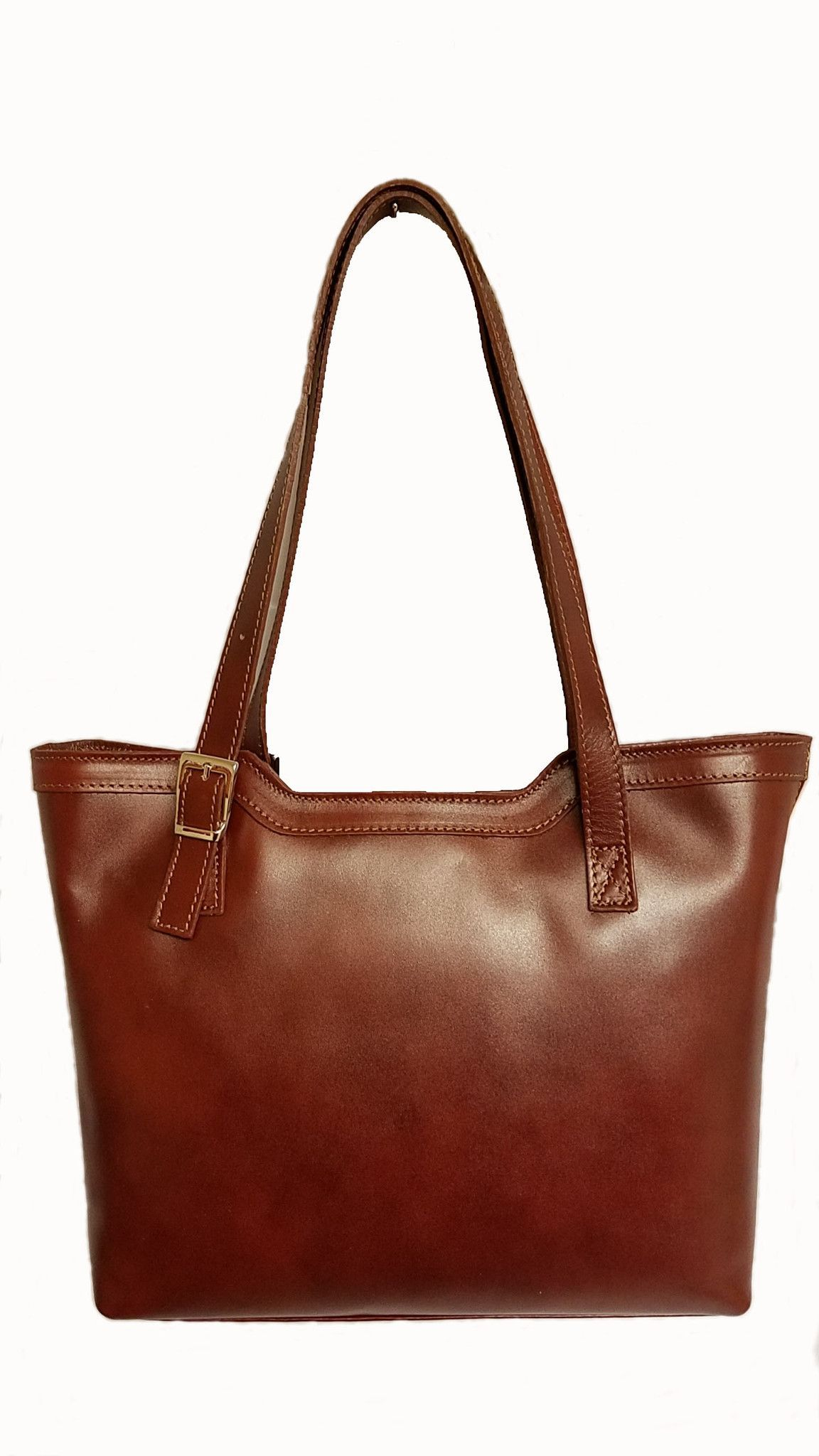 Bag genuine cowhide leather External material  cowhide leather tanned.  Inner Material  lining. Inside  2 compartments effec524b7817