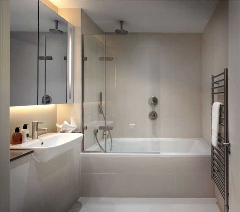 In This Neutral Contemporary Bathroom The Ceiling Mounted Shower