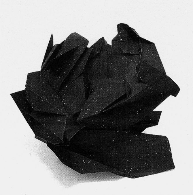 God knows why I'm attracted to what looks like a clump of badly printed black paper that is actually a sculpture.