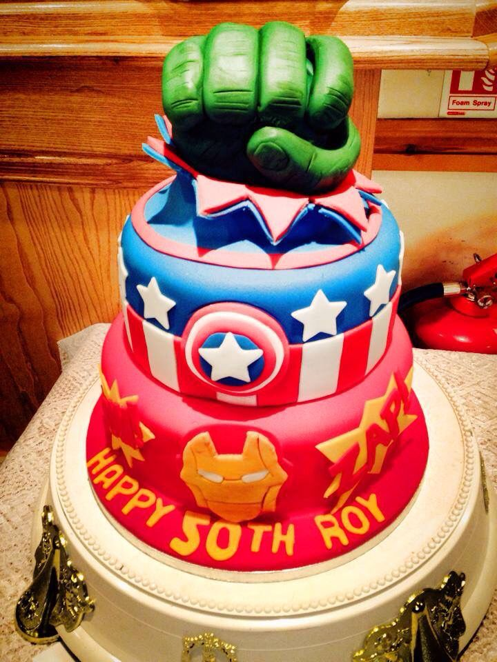 Marvel cake complete with captain America iron man and hulk fist