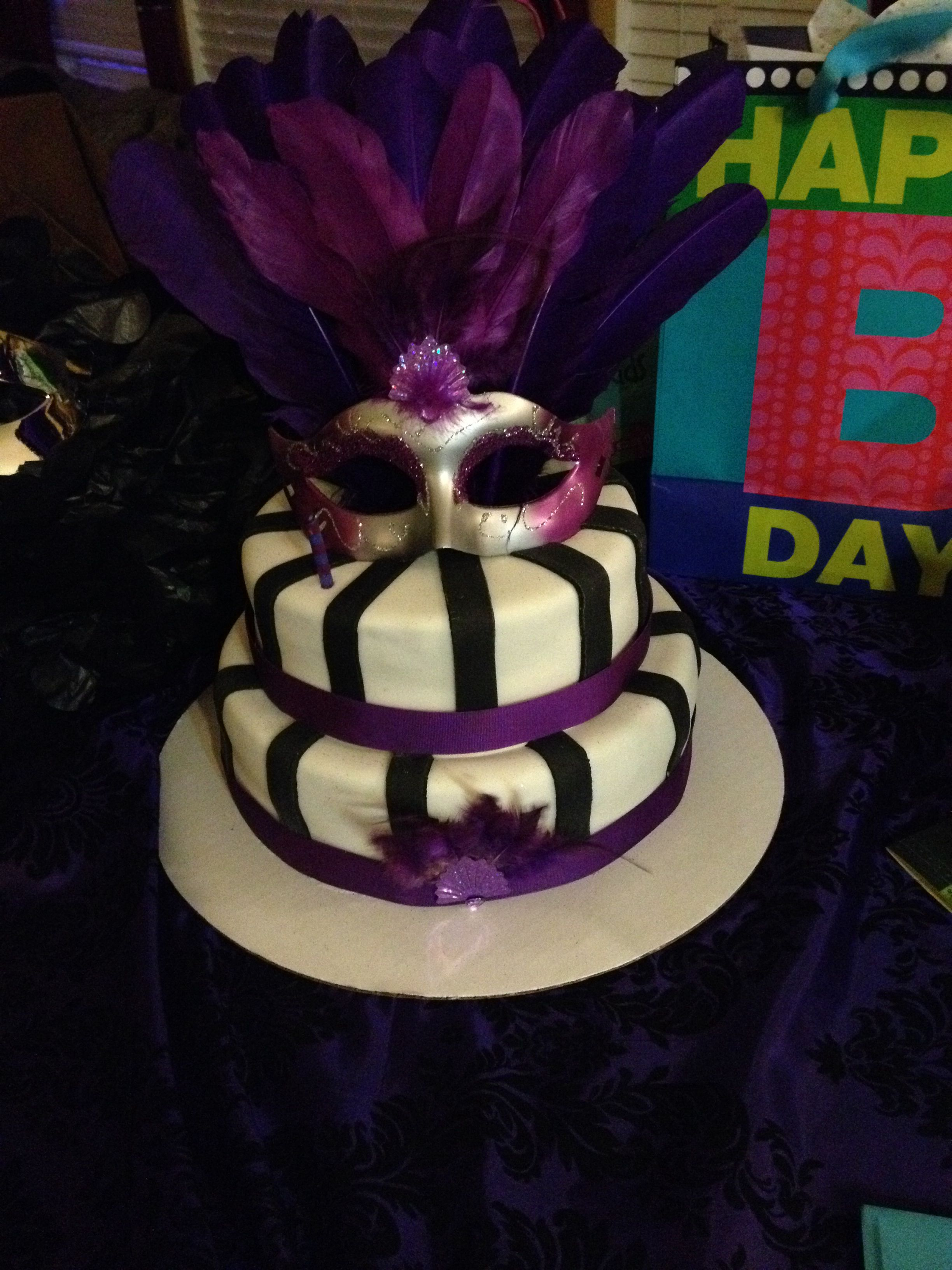 Black white and purple mascarade cake with images
