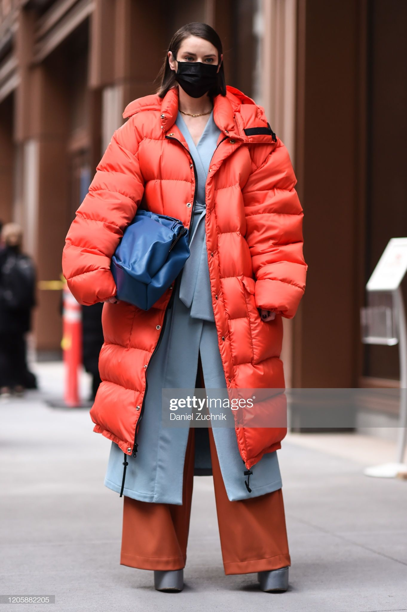 Marina Ingvarsson is seen wearing an orange puffer coat ...