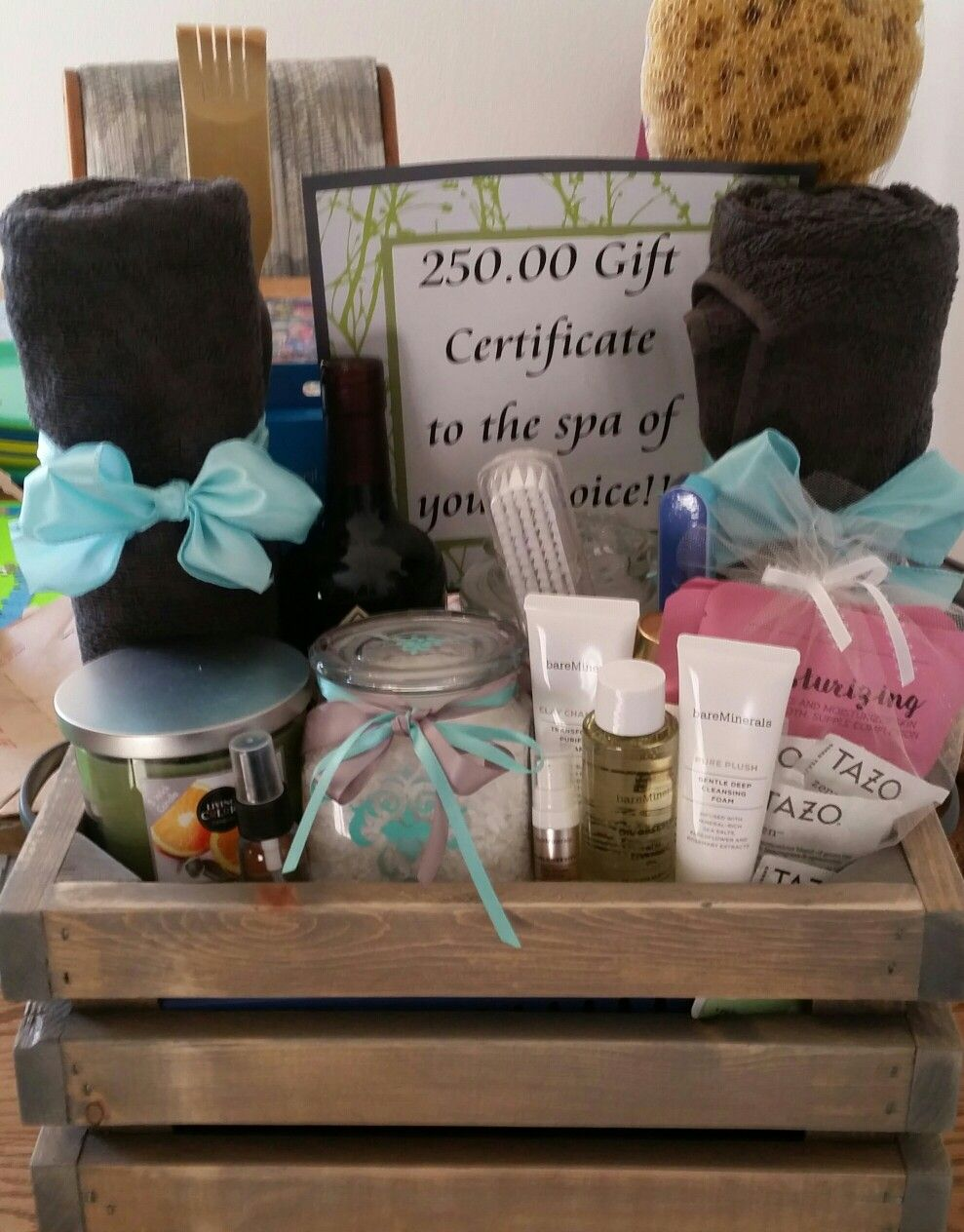 Handmade crate, bath salts and bath bombs stored in hand painted jars for a DIY spa day gift basket.
