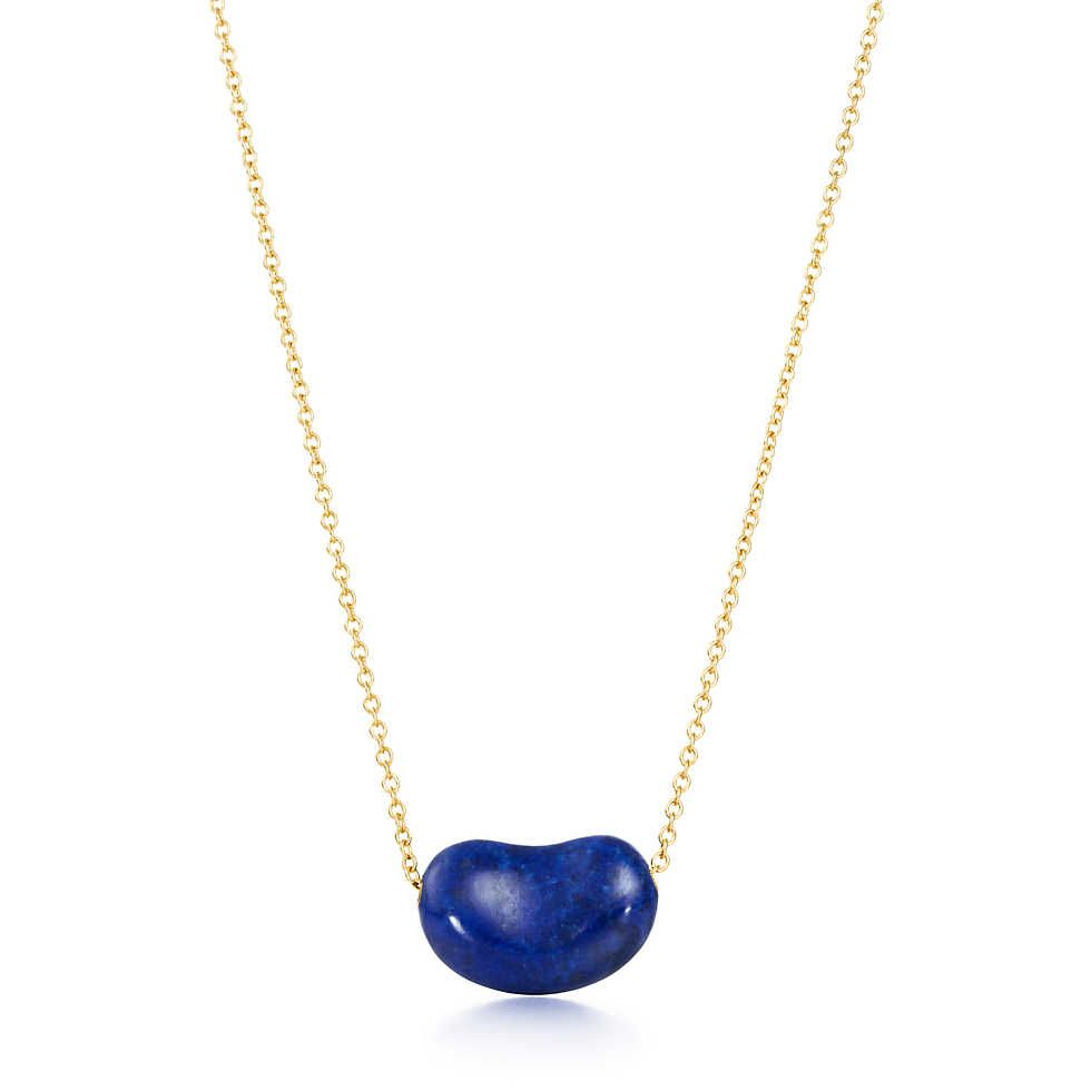4766666ac Elsa Peretti® Bean® pendant in 18k gold with lapis lazuli. | Tiffany & Co.  Getting this in New York -N