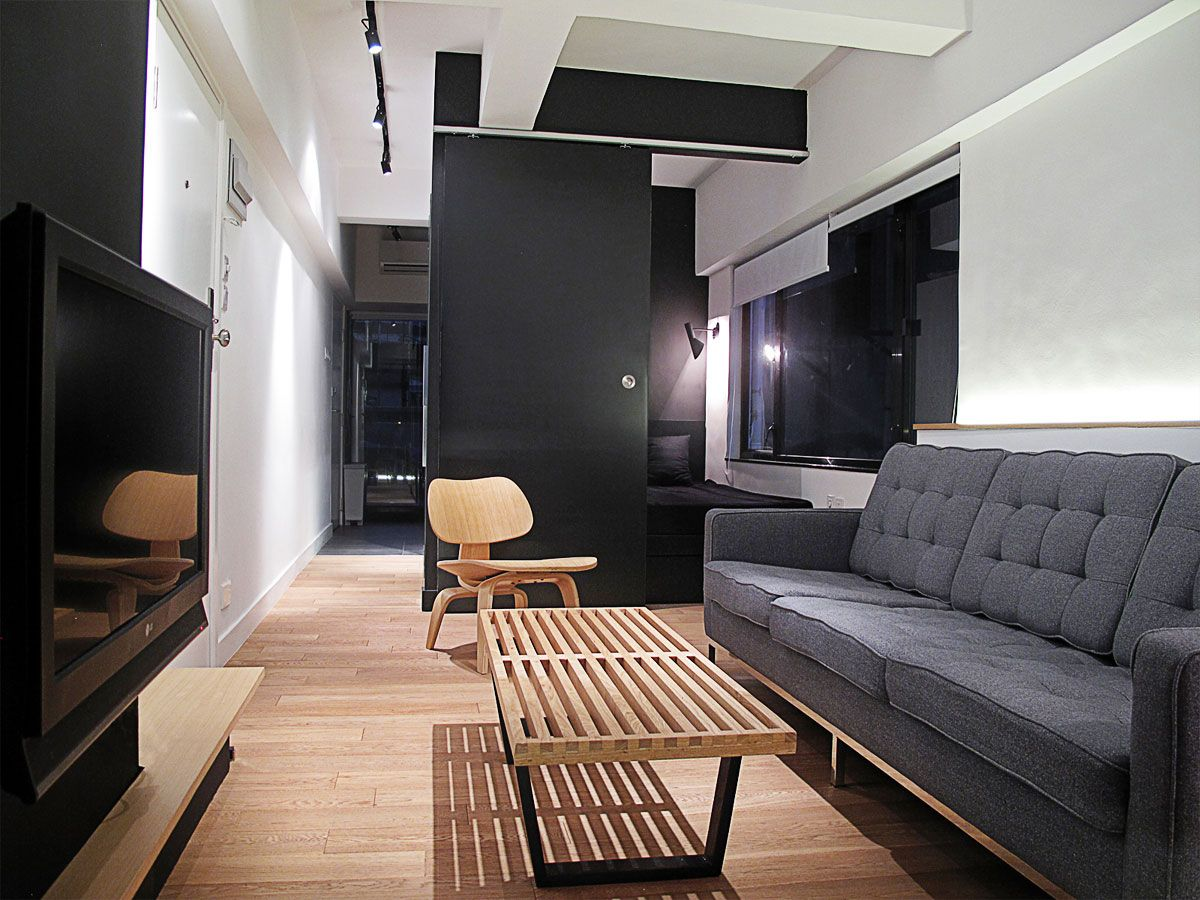 Apartment Invader Living Room With Black Sofa And Wooden Coffee Table White Wall Paint Color In Hongkong By OneByNine Studio Space Invaders
