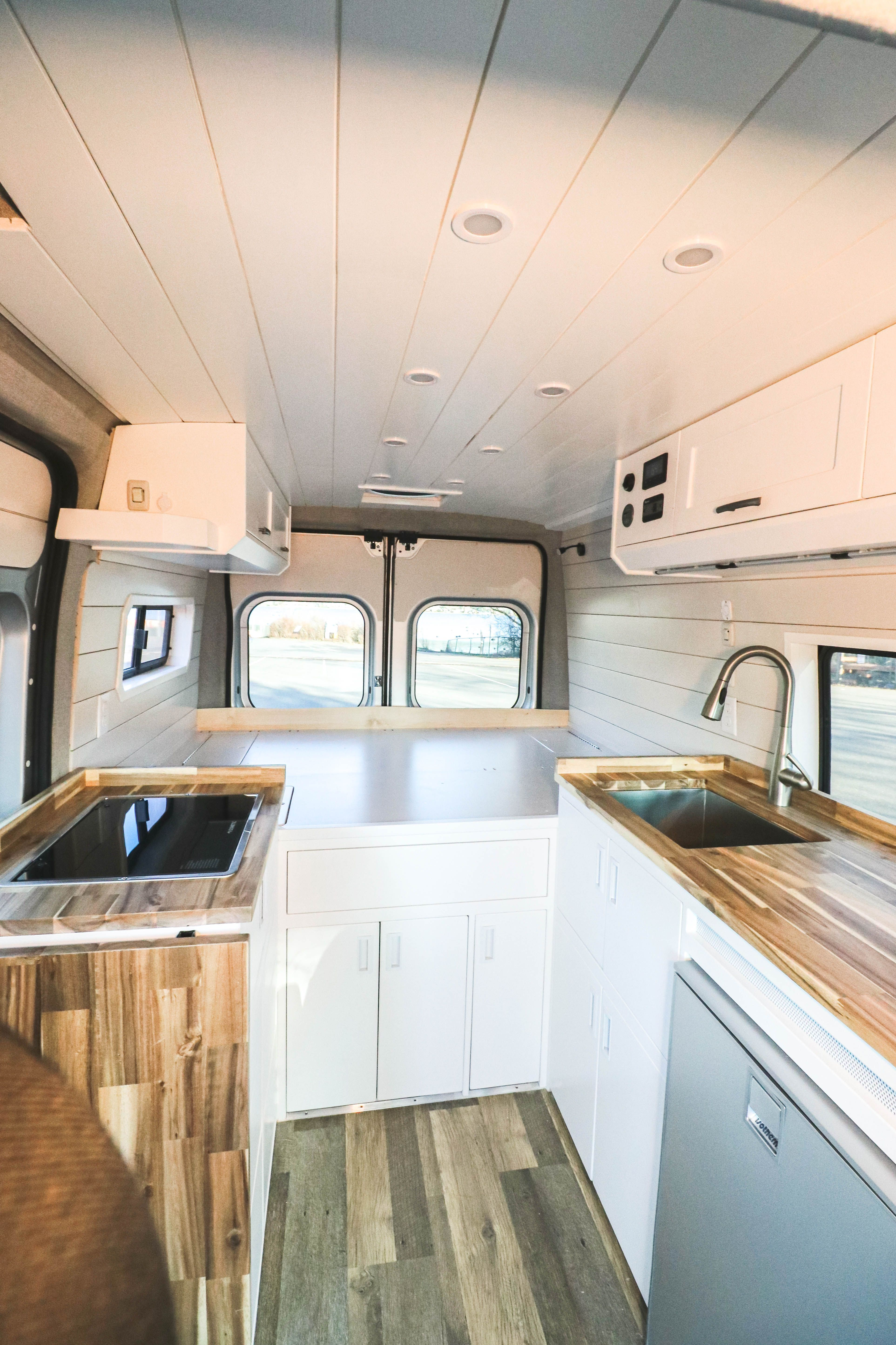 What do you think of this bright and airy Promaster conversion by Freedom Vans? #van #vanlife #promaster #vanconversion #vanideas #tinyhome #tinyhouse #tinyliving #convertedvan #rampromaster #convertedvan #vanconversioncompany #homeonwheels #bellingham #washington