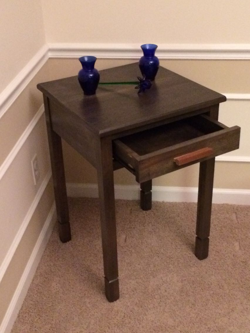 Custom side table. Made from poplar wood. Stained with ebony stain. Pullout drawer with dovetail handle.