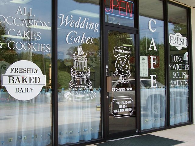 Outdoor vinyl window graphics lettering signs by tomorrow of