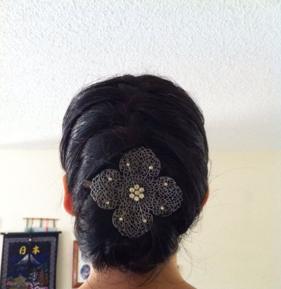 Cute french braid then tuck the tail under and add an accessory