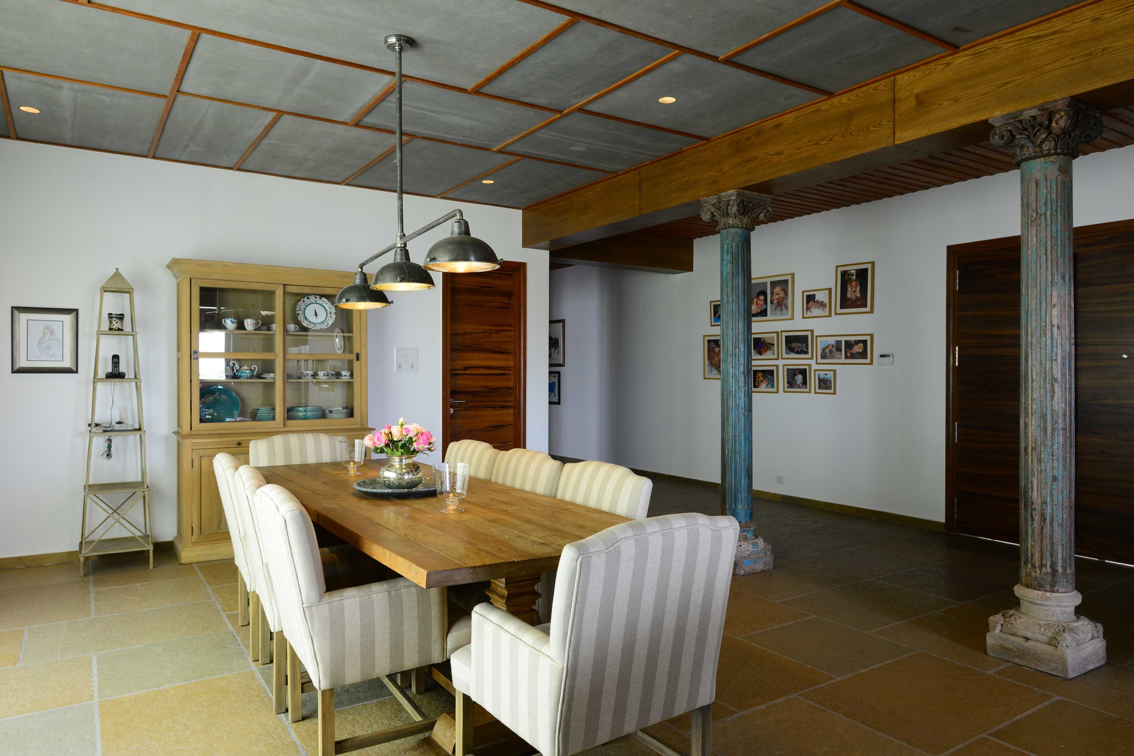 dining room with wooden table design by architect hameeda room