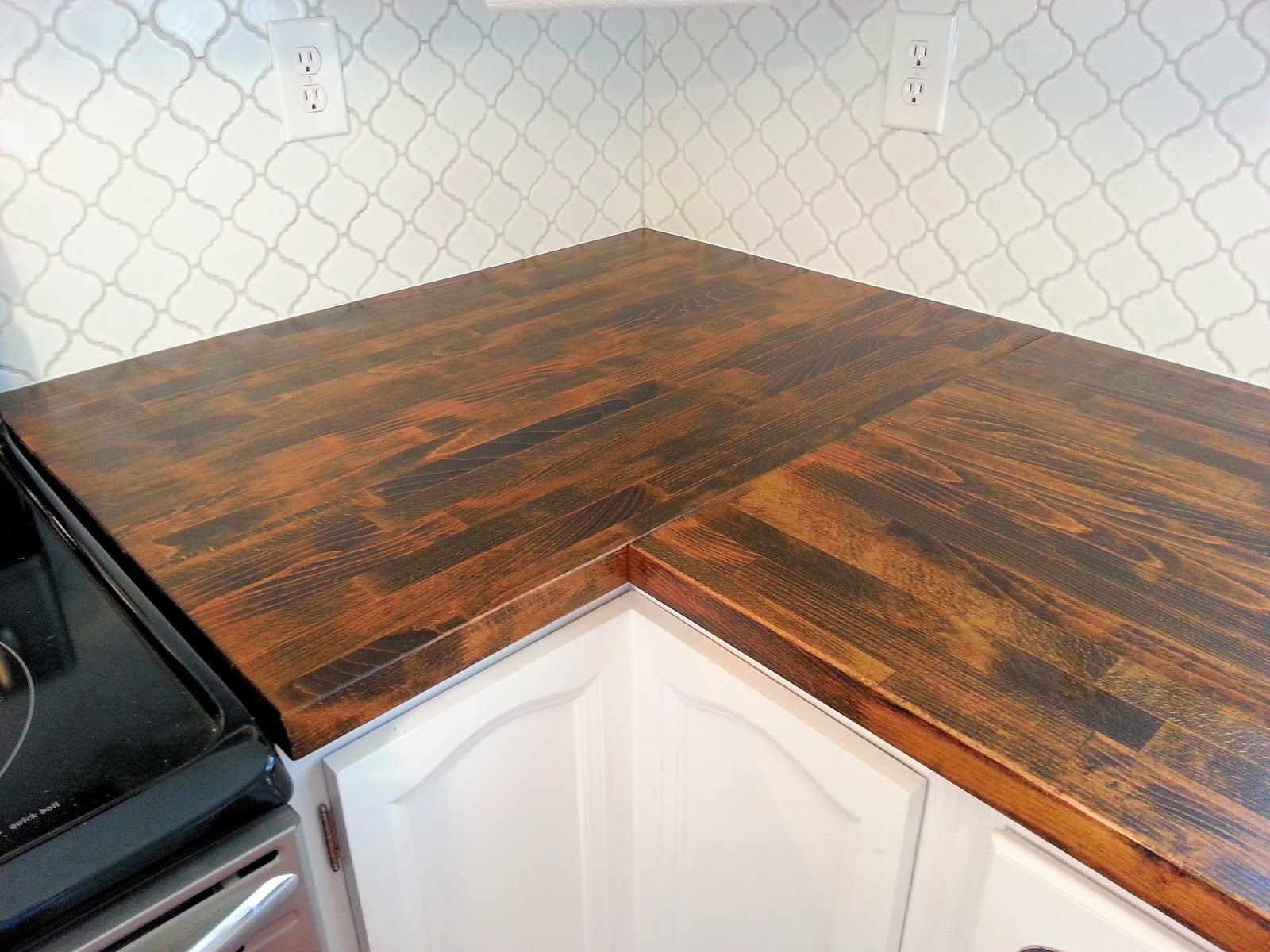 Stained ikea butcher block countertop and moroccan tile for Ikea countertops review