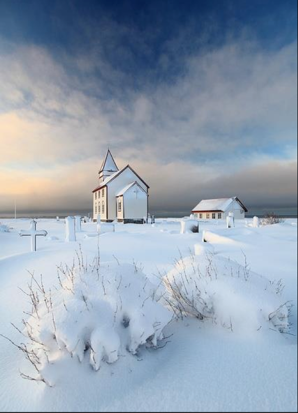 Church and cross in snow
