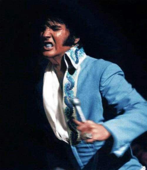 Elvis Presley wearing the blue brocade suit