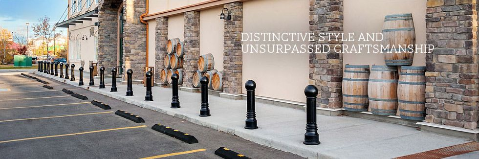 a row of relince foundry's decorative bollards sits at the edge of
