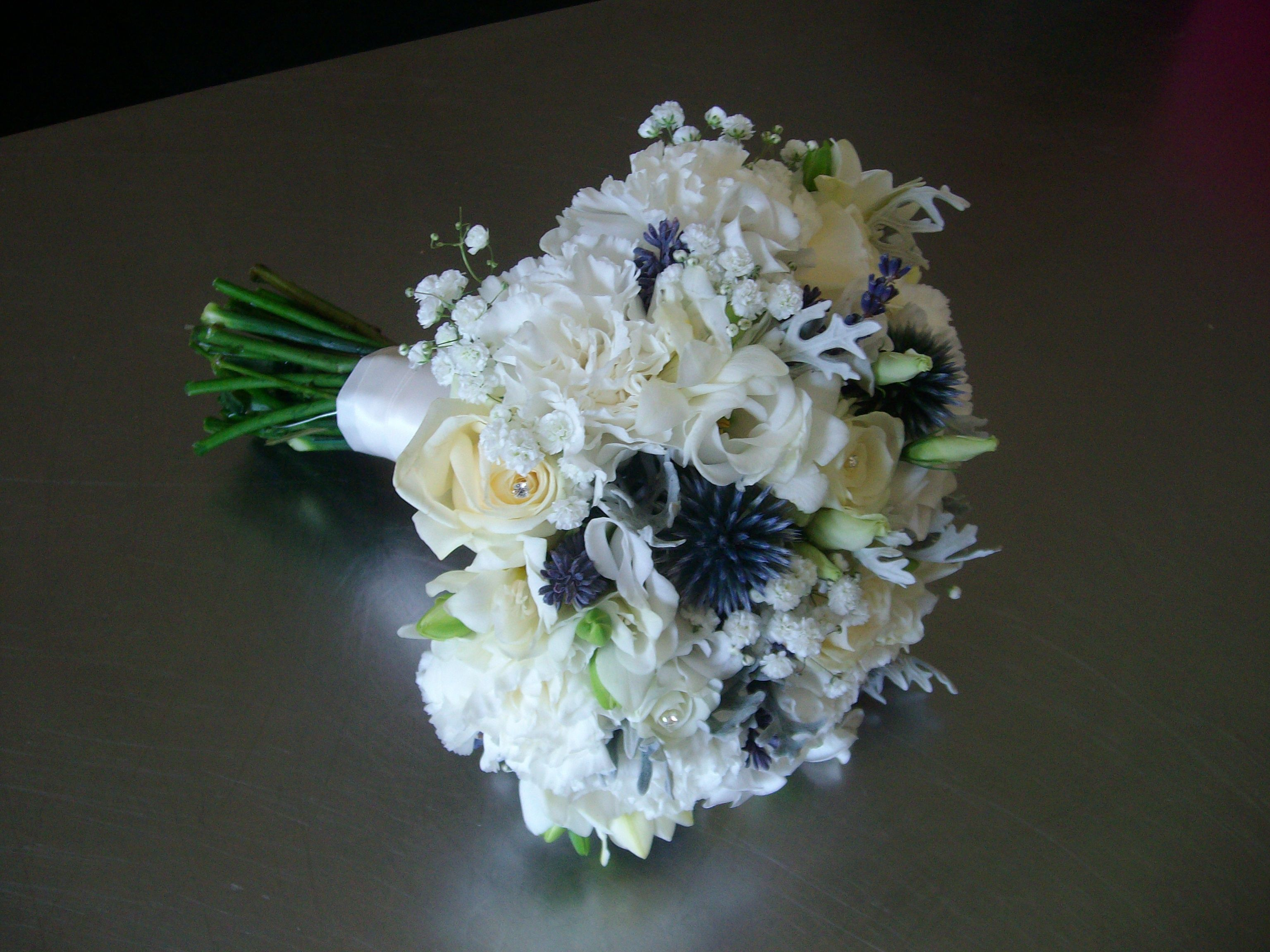 A Navy and Ivory fresh flower bridal bouquet by Celebration Moments