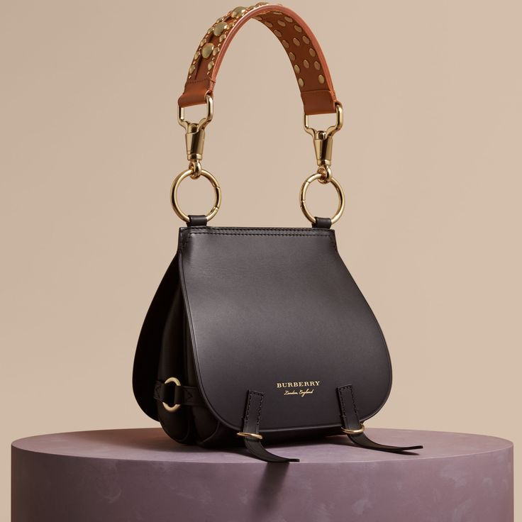 An equestrian-inspired runway satchel in smooth bridle and grainy leathers  from Burberry. Reflecting traditional British saddlery 917cd06f36baf