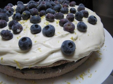 Luxury lemon and white chocolate cake topped with blueberries. Sweet and tasty.