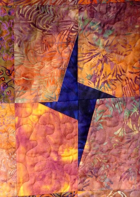 HGTV's 2012 color of the year is Tangerine Tango. I think this StarLit Batik Quilt by clubaloha on Etsy fits in with that color scheme.