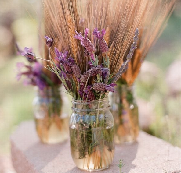 If you decide to go rustic, this could be a less expensive way to do center pieces... Fewer flowers needed.