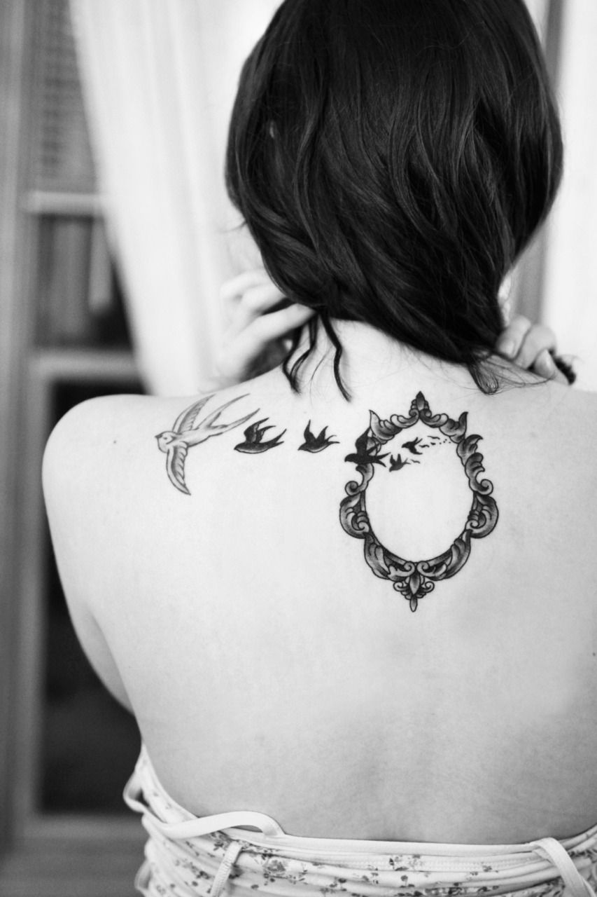 Tattoo Inspiration: An antique picture frame that also resembles a mirror and silhouetted swallows create a stunning tattoo that represents photography.