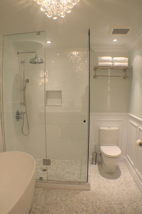 All glass shower enclosure in traditional bathroom