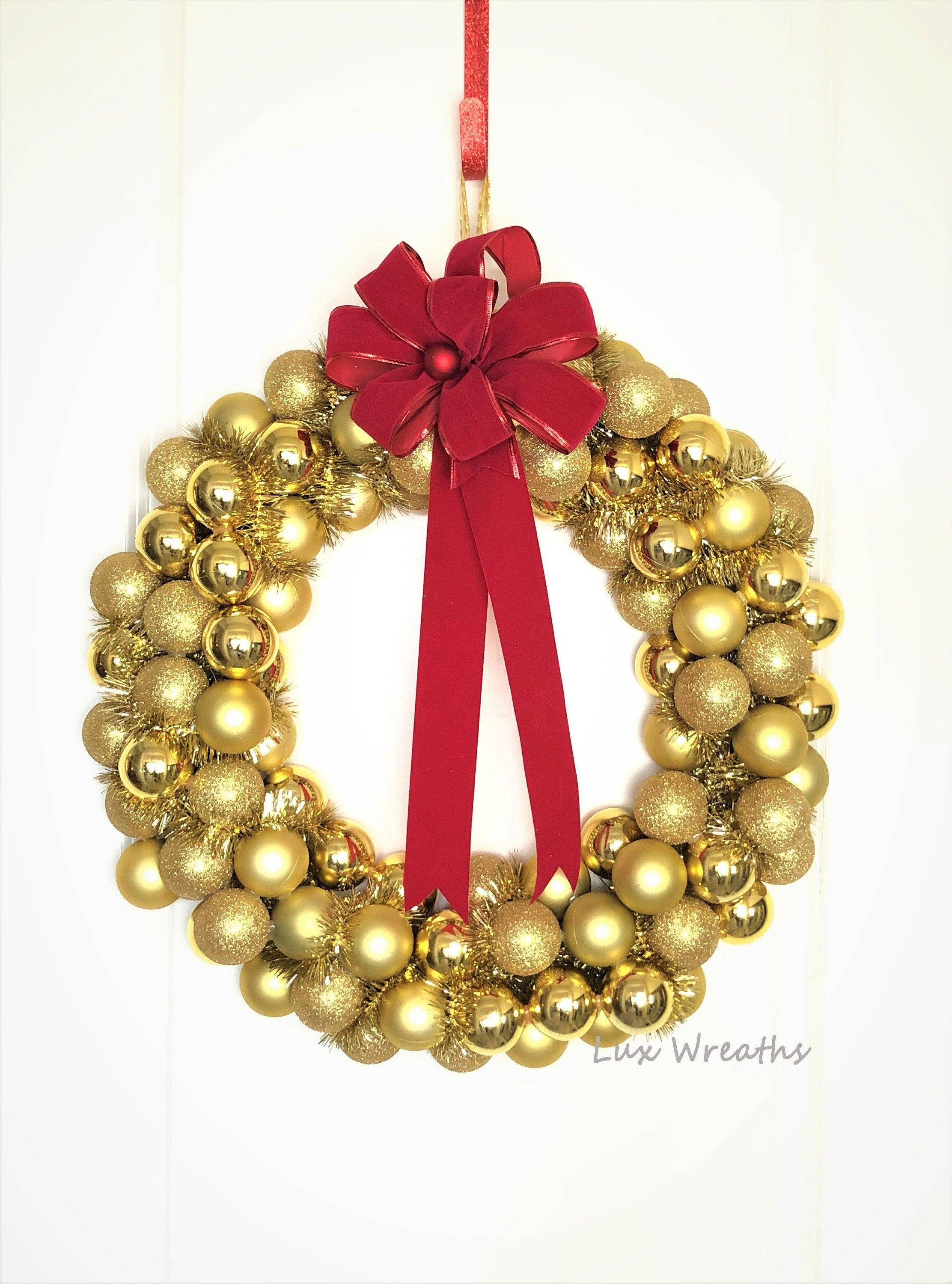 Christmas Ornament Wreath Gold Color With Large Red Bow By Etsy Ornament Wreath Christmas Ornament Wreath Red Ornaments