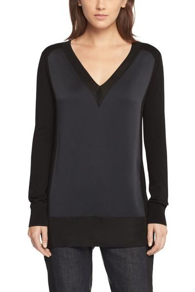 """Easy long sleeved V-neck topSatin back crepe main body100% Tonal fine-gauge rayon rib at sleeve patch, neck trim, & hem100% Tonal extra fine-gauge merino at shoulder patches, side panels, sleeves, & cuffsEasy, tunic fitModel is 5'9"""" wearing size Small"""