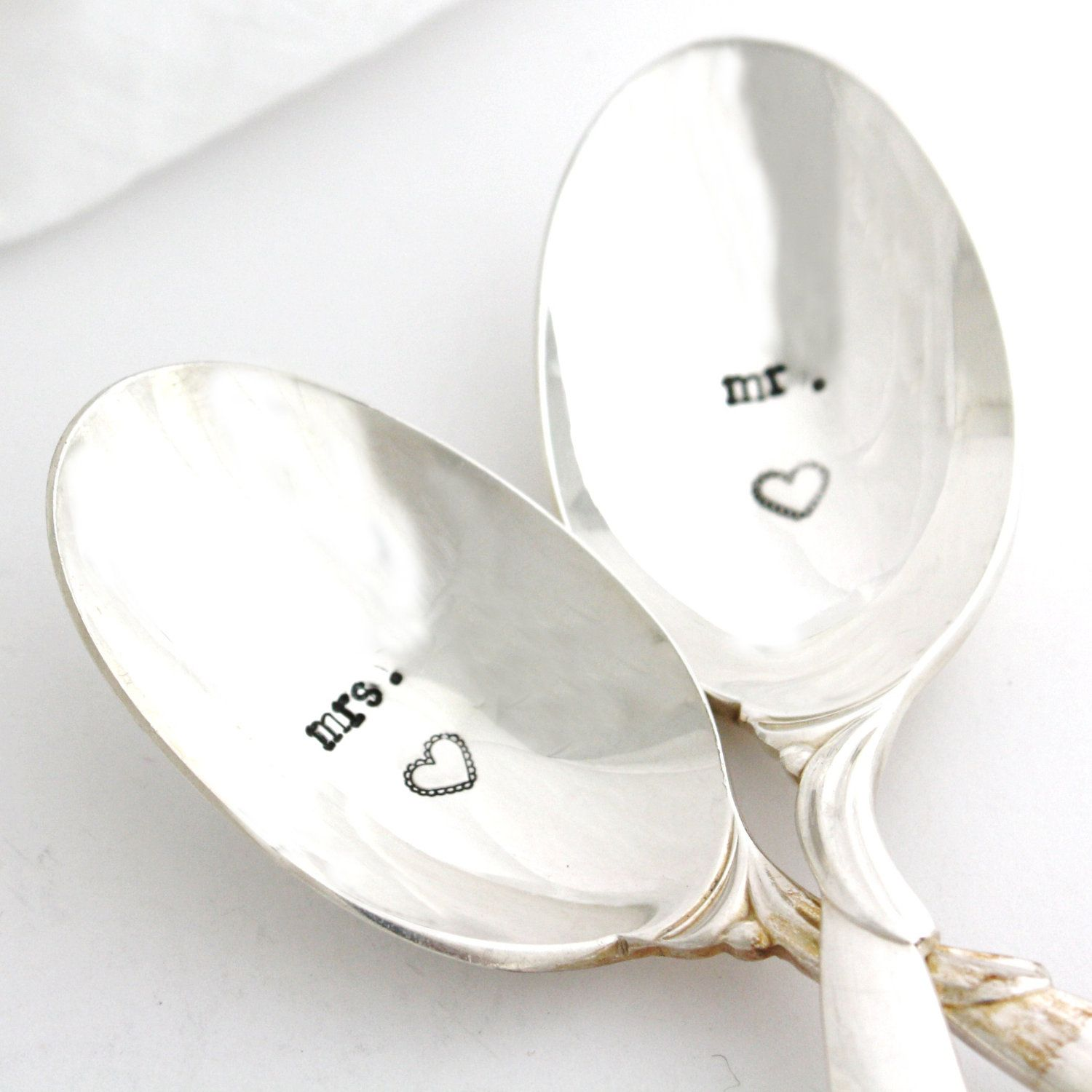 Mr. and Mrs. hand stamped silverware.