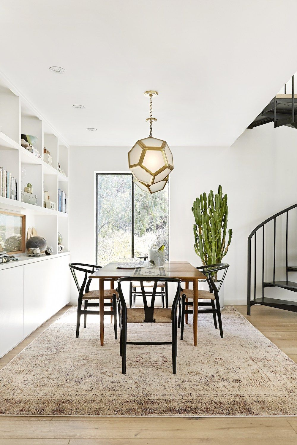 Beautiful dining room with black wishbone chairs, neutral