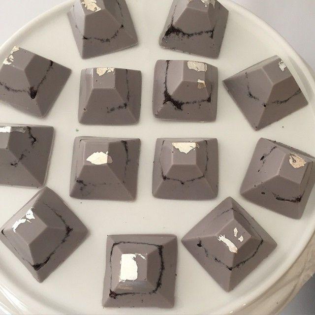 Handmade grey chocolates with silverleaf and a layer of Oreo-bites by #alaroch #sugarcoatedmama Sydney, Australia